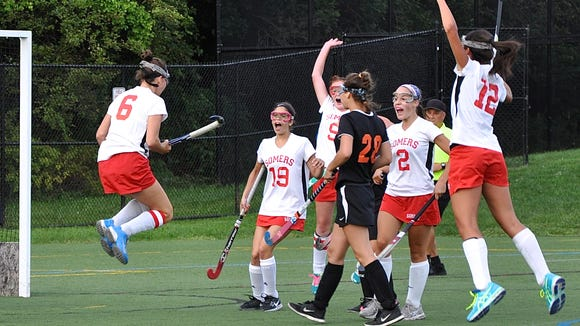 Taylor Turchick (6) jumps and celebrates with teammates after she scored what proved to be the winning goal in Somers' 1-0 win over Pawling  during the opening day of the Somers Tournament.