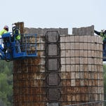 Workers continue to dismantle the 100-year-old silos on the Woodward Inc. campus on Thursday, April 28, 2016.