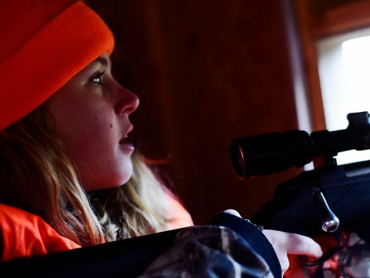 Taylor Howell pauses after shooting a deer from a blind on her grandparents' property on the last day of deer rifle season. Howell is one of a growing number of female hunters in York County.