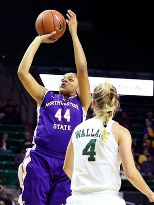 Northwestern State forward Tia Youngblood (44) shoots past Baylor guard Kristy Wallace (4) in the first half of an NCAA college basketball game.