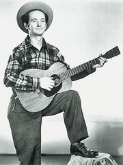 Woody Guthrie, singer, songwriter, dean of American folk artists, in a 1947 publicity photo.
