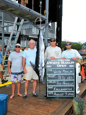 In this Aug. 9, 2016 photo provided by Larry Jock, Phil Heasley, second from left, poses with his catch and team at the White Marlin Open fishing tournament in Ocean City, Md. Heasley caught what was deemed the tournament's only qualifying white marlin, but he was denied over $2.8 million in prize money because he and his crew failed to pass lie-detector tests about whether they followed tournament rules. A federal judge ruled against Heasley in June after a nine-day trial, and Heasley is appealing the ruling. (Larry Jock/Coastal Fisherman via AP)