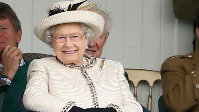 Queen Elizabeth II watches the Braemar Highland Games on Sept. 6, 2014.
