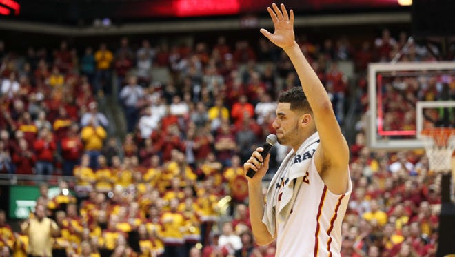 Iowa State's Georges Ninag waves to the crowd while giving an address following the Cyclones' win. The game was Niang's last at Hilton Coliseum.