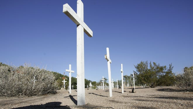 Unmarked wooden crosses mark gravesites at Camelback Cemetery, in Paradise Valley. The site is still open for burials although they are very infrequent, because of a lack of space.