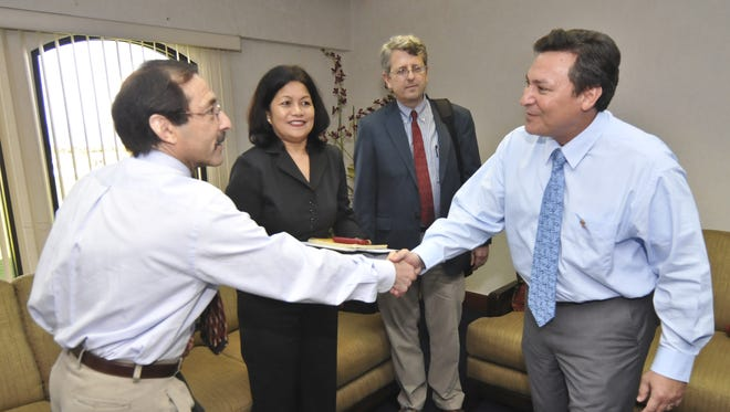 David Gootnick, left, of the U.S. General Accounting Office, is greeted by Gov. Eddie Calvo as they me at the Governor's Complex in Adelup in February 2011.