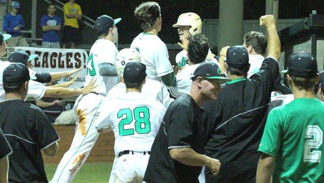 After Matthew Estrada's three-run, walkoff homer won it,  Catholic High had a home plate mob scene last Tuesday in the Region 1-4A quarterfinal win against Jacksonville-Epsicopal