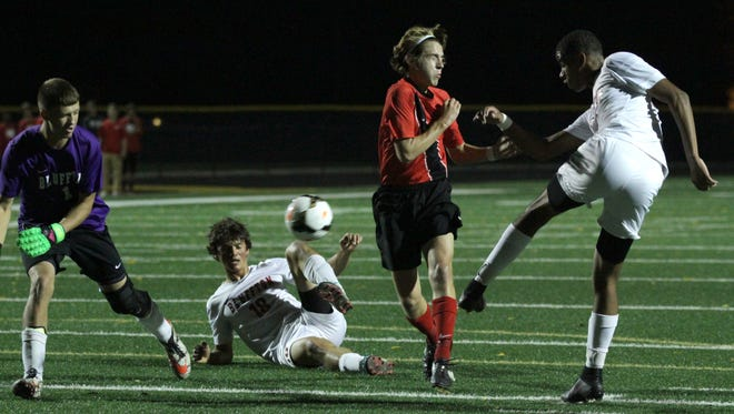 Mansfield Christians Jared Mount scores a goal against  Bluffton at Tiffin High School on Wednesday night in Division III semifinals.