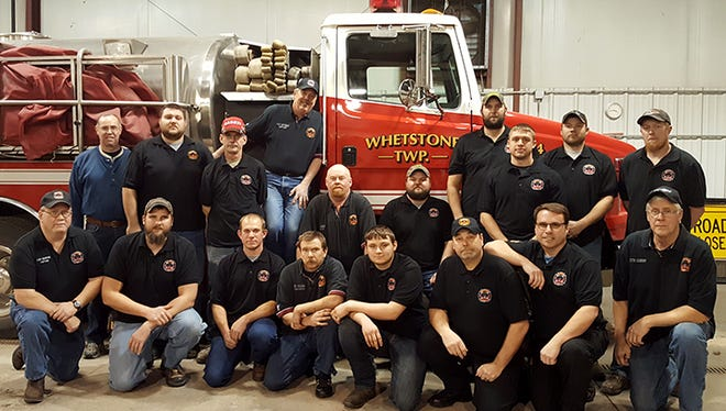 From left, front, are Capt. Lee Haefer, Eric Spiegel, Dan Wagner, Ed Sulser, Isaak Sulser, Bill Johnson, Chief Mike Motter, Keith Eichhorn; and back, Chaplain Tim Wingert, Mitch Alt, Captain Brian Caldwell, Captain Dale Garverick, Assistant Chief Steve Jones, Mike Wilson, Captain Adam Spiegel, Aaron Starr, Matt Starr and Chris Teneyck.