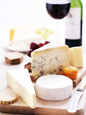 A well-balanced cheese plate usually includes a hard, soft and blue cheese selection, as well as some dried fruit or nuts, crackers and bread.