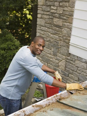 Cleaning out the gutters will prevent snow from building up under roof shingles and causing leaks.