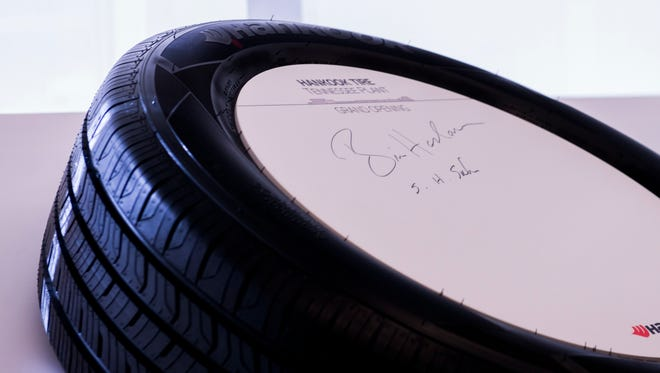 Governor Bill Haslam signs a tire at Hankook's grand opening on October 17, 2017.