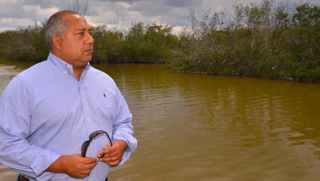 Cocoa Beach Mayor Ben Malik by the Banana River in Cocoa Beach. The lagoon is looking as brown as it ever has from algae.