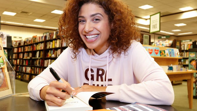 "Yonkers resident Kaylah Pantaleon, 28, signs a copy of her book, ""Oprah Girl, Memoirs of a falling facade,"" at Barns & Noble Booksellers in Yonkers on Friday, April 14, 2017."