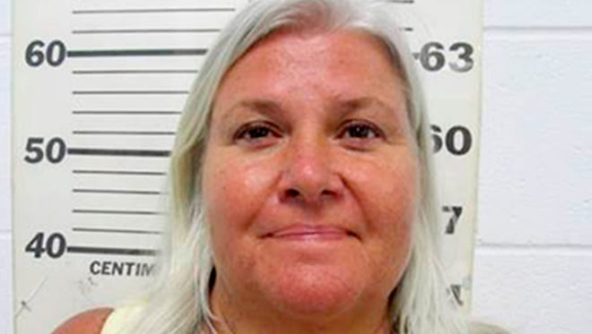 This photo provided by the South Padre Island Police Department shows Lois Riess, of Blooming Prairie, Minn., who was arrested by federal deputy marshals Thursday, April 19, 2018, at a restaurant in South Padre Island, Texas. Investigators believe she killed her husband in Minnesota then fled to Florida where she used the same gun to slay her doppelganger with the intention of assuming her identity. Riess had been on the run since at least late March.