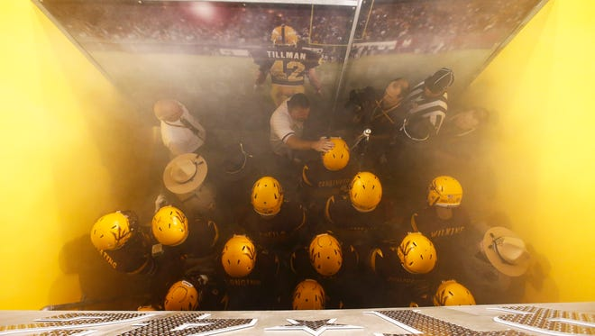ASU head coach Todd Graham talks to his players in the Tillman Tunnel before a 2015 game against Cal at Sun Devil Stadium.