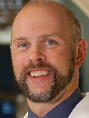 Dr. Brett Faulknier