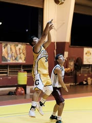 A Triton attempts to make a shot during a game against the Typhoons. The Typhoons won 84-66.