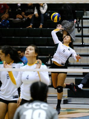 UOG's Kristi Stone serves against GCC.