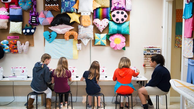 From left to right, Audrey Langeloh, 12, Katherine Angstrom, 12, Shelby Kahn, 12, Lauren Johnston, and Hannah Ogden, 12, work on projects at the sewing stations during a group class on Thursday, January 11, 2018 at Sew Easy Naples in North Naples. Johnston opened Sew Easy to offer children and teens lessons in sewing.