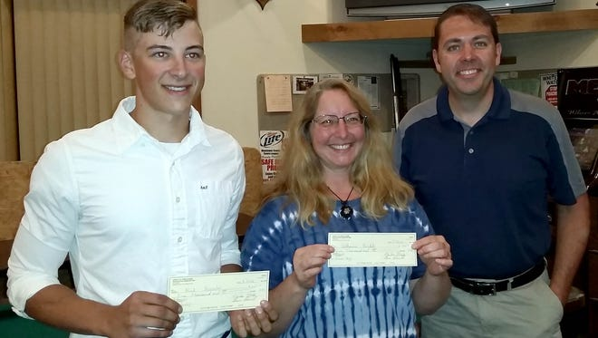 Alek Henseler (from left) and Catherine Henkle, Manitowoc County Fish and Game Protective Association scholarship winners, accepted their $1,000 from Dan Dufek, scholarship chairman, during the August meeting. Not available for the photo were Paige Arneson and Preston Konop.