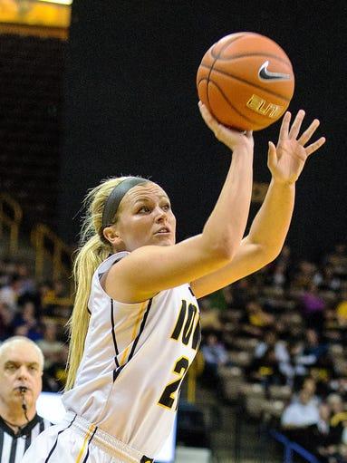 Iowa's Melissa Dixon (21) fires a three-point shot