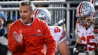 Ohio State Buckeyes head coach Urban Meyer leads his team on the field prior to the game against the Penn State Nittany Lions at Beaver Stadium on Oct. 22.