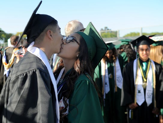 Angel Polido kisses his girlfriend, Alice Magana, before