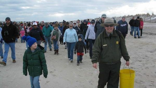 Rangers lead a First Day Hike at Assateague State Park.