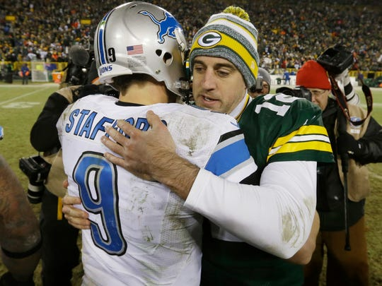 Green Bay Packers' Aaron Rodgers (12) embraces Detroit Lions' Matthew Stafford (9) after an NFL football game Sunday, Dec. 28, 2014, in Green Bay, Wis. The Packers won 30-20.