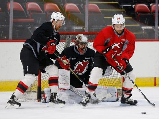 From left, Binghamton Devils players Yarloslav Dyblenko,
