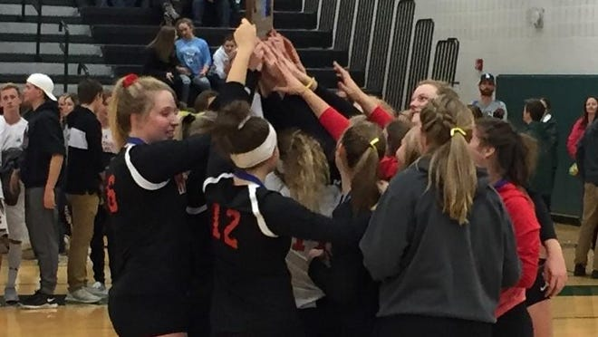 The Rocori volleyball team celebrates its West Sub-Section 6-2A championship Thursday at Sauk Rapids. The Spartans beat St. Cloud Cathedral 30-28, 25-19, 16-25, 25-23.