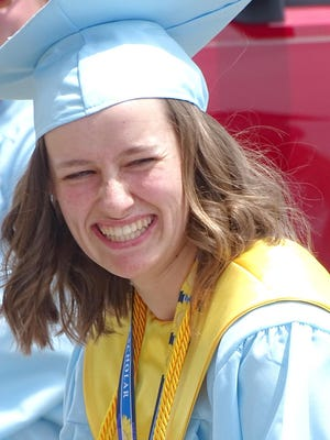 Senior Abby Brown shares a funny moment with the graduates during the senior video. Brown produced the video that brought smiles and tears to the grads and families.