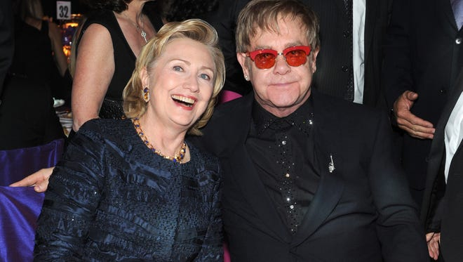 Hillary Clinton and Sir Elton John attend the Elton John AIDS Foundation's annual benefit on October 15, 2013 in New York City.