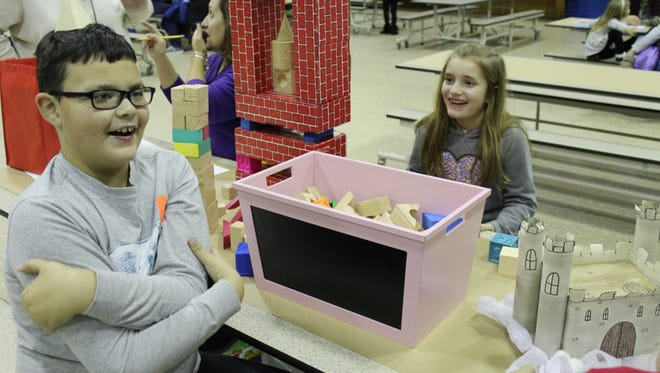 """Jaden Molter-Castiglioni and Lea Bellusci build castles to be models for their castle drawings during a """"Medieval Times"""" Family Art Night at Winslow Elementary School."""