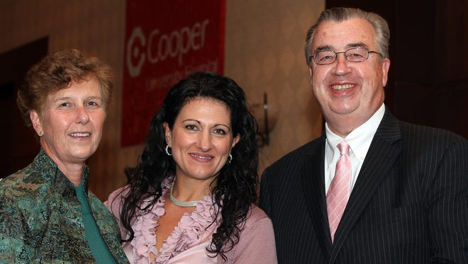Joyce, left, and John Sheridan, Dina Mathews of Cherry Hill, second from left, at the Cooper Cancer Institute Pink Roses Teal Magnolias brunch, Sunday, October 3, 2010 at Crowne Plaza, Cherry Hill.