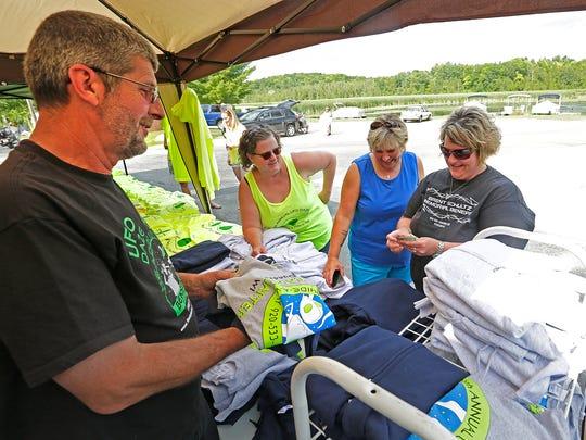 George Huiras of Campbellsport sells a UFO Daze shirt