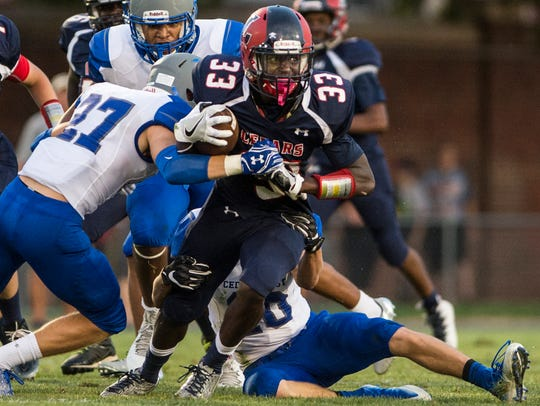 Lebanon's Jeremiah Beckley tries to get away from a