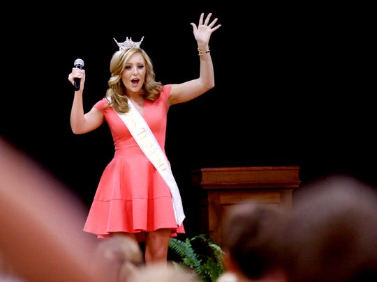 Miss Tennessee 2016, Grace Burgess, gets Milddle Tennessee Christian School students to get up and move and before talking with and answering questions from students on Thursday, Oct. 13, 2016, during an appearance at the school.