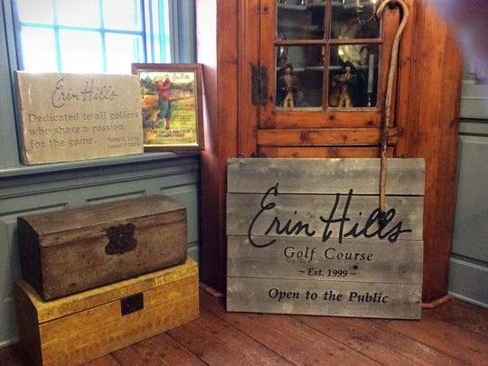 In Bob Lang's office in Delafield he keeps two reminders of Erin Hills: the small wooden sign that once marked the entrance, and the cornerstone, chiseled out of the original clubhouse.