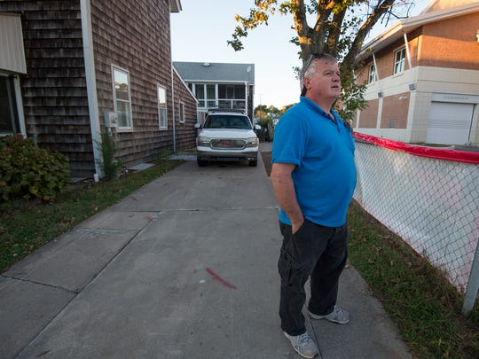 Leonard Tylecki stands outside his childhood home, which is next to the Rehoboth Beach City Hall.