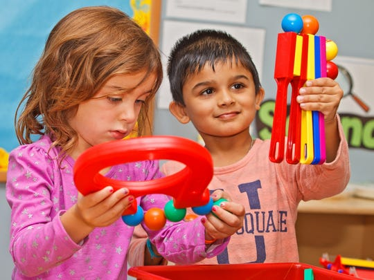 Children experiment with magnets at the Jan and Niles Davies Learning Center, West Haverstraw.