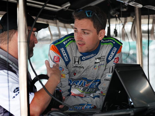 Andretti Autosport IndyCar driver Stefan Wilson (25) talks with his crew practice for the Indianapolis 500 at the Indianapolis Motor Speedway on Thursday, May 17, 2018.