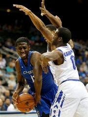 Creighton forward Cole Huff, left, is pressured by Seton Hall guard Khadeen Carrington, right, and forward Desi Rodriguez.