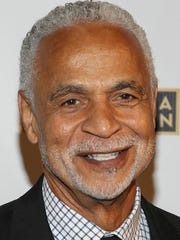 """FILE - In this Sept. 17, 2013 file photo, actor Ron Glass arrives at the 65th Emmy Awards Nomination Celebration at the Academy of Television Arts and Sciences in Los Angeles. Glass, the handsome, prolific character actor best known for his role as Ron Harris, the gregarious, sometimes sardonic detective in the long-running cop comedy """"Barney Miller,"""" has died at age 71. Glass died Friday, Nov. 25, 2016, of respiratory failure, his agent, Jeffrey Leavett, told The Associated Press on Saturday."""