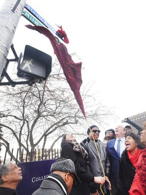 """Motown legend Stevie Wonder unveils the new street sign """"Stevie Wonder Ave."""" along with Motown Museum chairwoman Robin Terry, Detroit Mayor Mike Duggan, City Council President Brenda Jones and Congresswoman Brenda Lawrence. during a ceremony in Detroit, Wednesday, Dec. 21, 2016.  A portion of Milwaukee Street was renamed Stevie Wonder Ave."""