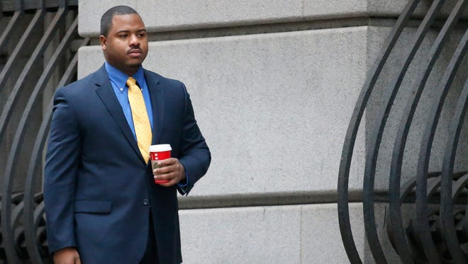 FILE - In this Nov. 30, 2015 file photo, William Porter, one of six Baltimore city police officers charged in connection to the death of Freddie Gray, arrives at a courthouse for jury selection in his trial in Baltimore.