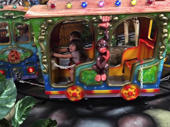 Austin and Isabella ride in the Train at Jambo Park