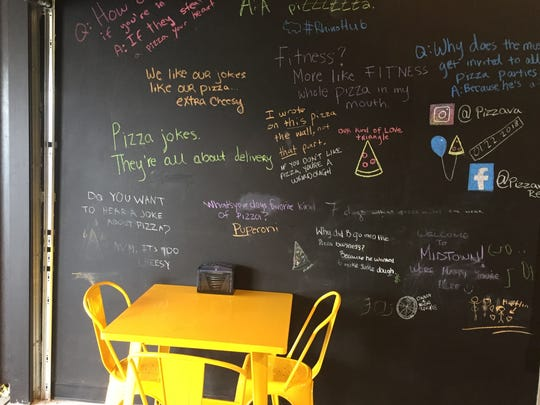 One wall of Pizzava, a new pizzeria in Midtown Reno, is a chalkboard on which customers are encouraged to share slices of pizza humor.