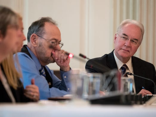 Price attends an opioid roundtable discussion at the